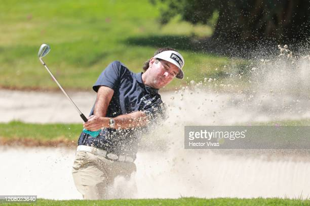 Bubba Watson of the United States plays a shot from a bunker on the first hole during the third round of the World Golf Championships Mexico...