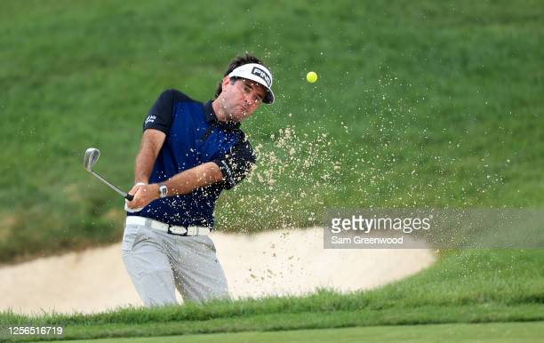 Bubba Watson of the United States plays a shot from a bunker on the 14th hole during the first round of The Memorial Tournament on July 16, 2020 at...