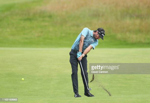 Bubba Watson of the United States plays his second shot on the 18th hole during the third round of the 148th Open Championship held on the Dunluce...