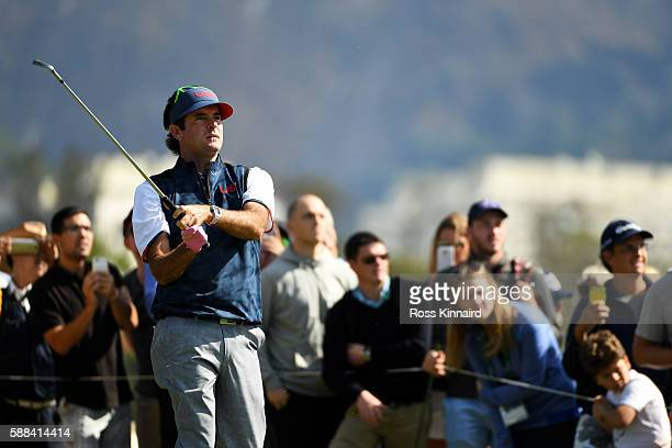 Bubba Watson of the United States plays his shot from the fourth tee during the first round of men's golf on Day 6 of the Rio 2016 Olympics at the...