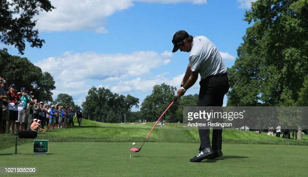 Bubba Watson of the United States plays his shot from the seventh tee during the first round of The Northern Trust on August 23, 2018 at the...