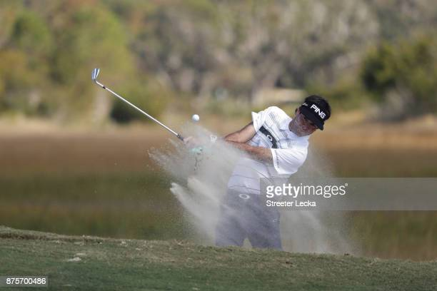Bubba Watson of the United States plays his shot out of the bunker on the fifth hole during the second round of The RSM Classic at Sea Island Golf...