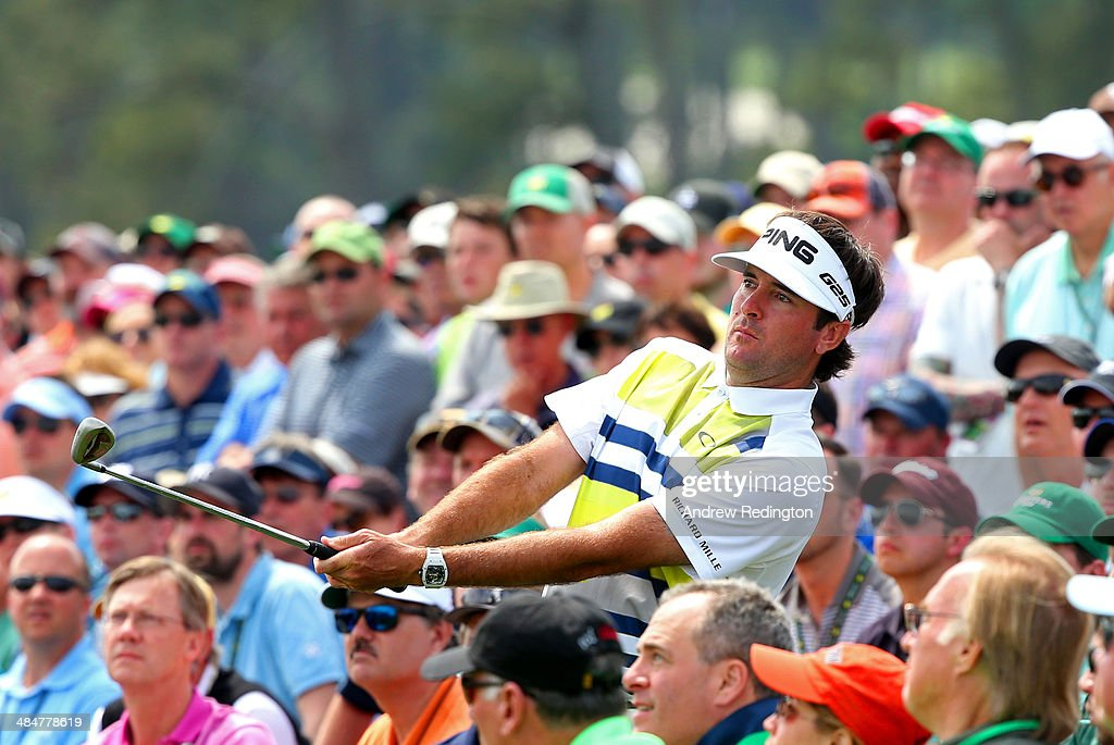 Bubba Watson of the United States plays his third shot on the 18th hole during the second round of the 2014 Masters Tournament at Augusta National Golf Club on April 11, 2014 in Augusta, Georgia.