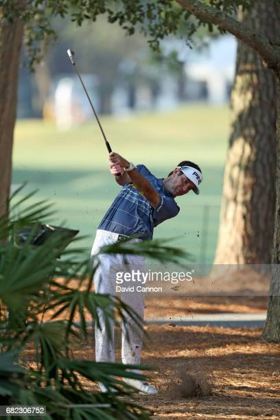 Bubba Watson of the United States plays his third shot on the par 4, 10th hole during the second round of THE PLAYERS Championship on the Stadium...