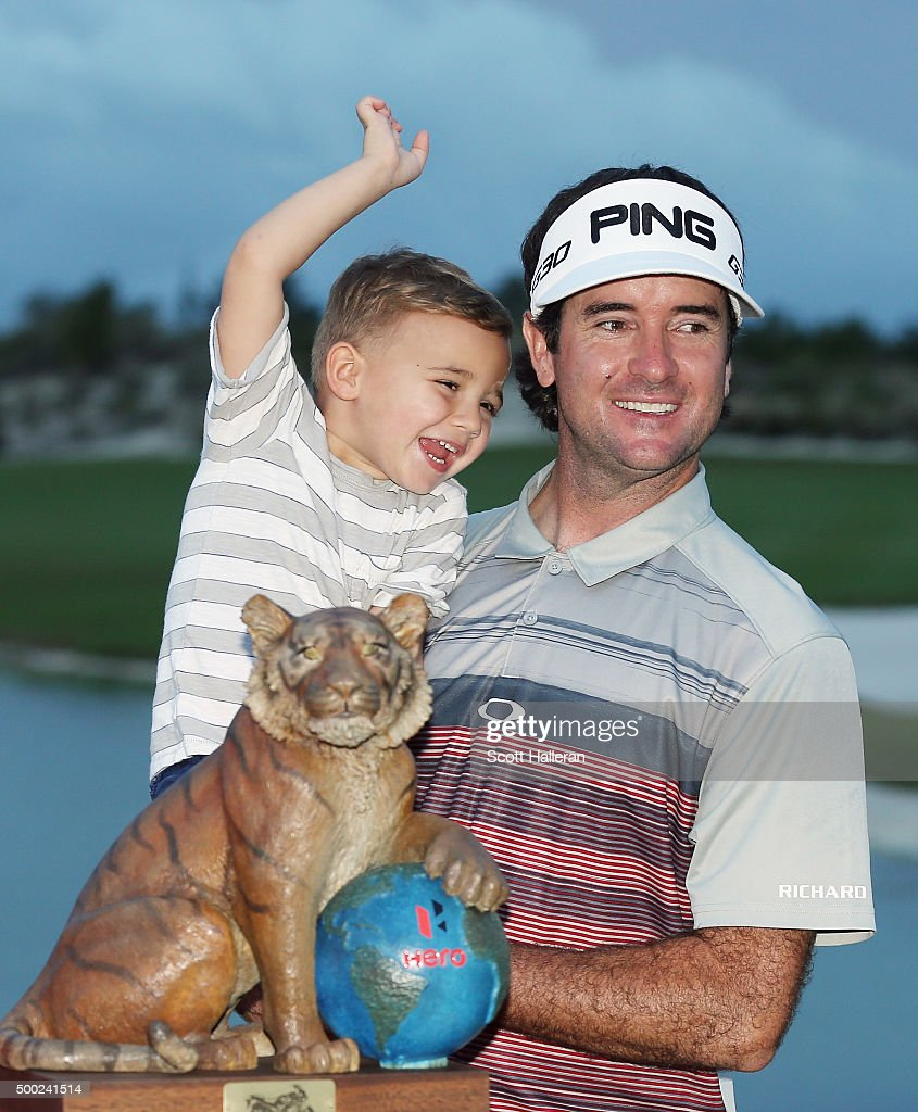Bubba Watson of the United States poses with his son Caleb and the trophy after his three-stroke victory at the Hero World Challenge at Albany, The Bahamas on December 6, 2015 in Nassau, Bahamas