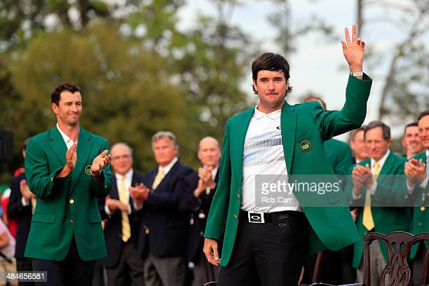 Bubba Watson of the United States poses with the green jacket after winning the 2014 Masters Tournament by a threestroke margin as Adam Scott of...