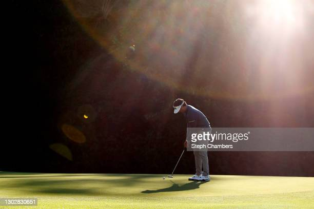 Bubba Watson of the United States putts on the 12th green during the first round of The Genesis Invitational at Riviera Country Club on February 18,...