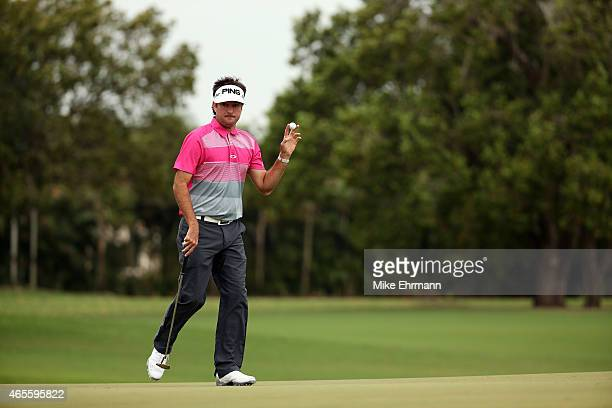 Bubba Watson of the United States reacts after putting out on the second hole green during the final round of the World Golf ChampionshipsCadillac...
