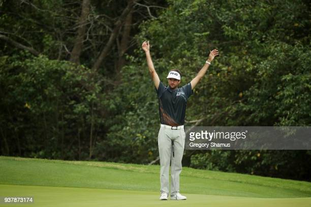 Bubba Watson of the United States reacts on the third green during his final round match against Kevin Kisner of the United States in the World Golf...