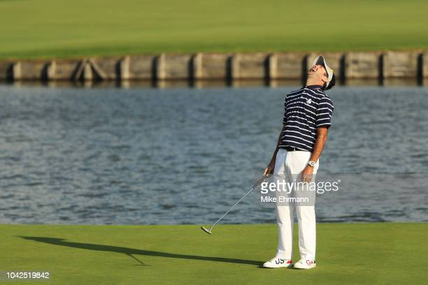 Bubba Watson of the United States reacts to a putt on the 15th during the afternoon foursome matches of the 2018 Ryder Cup at Le Golf National on...