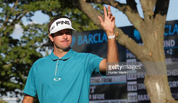 Bubba Watson of the United States reacts to his birdie putt on the18th hole during the second round of The Barclays at Plainfield Country Club on...