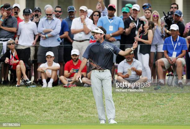 Bubba Watson of the United States reacts to his chip on the fifth hole during his final round match against Kevin Kisner of the United States in the...