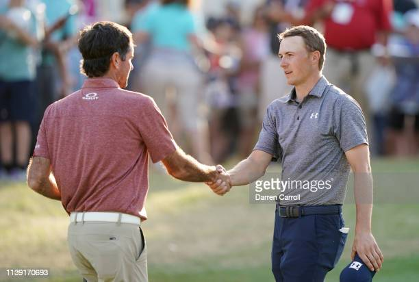 Bubba Watson of the United States shakes hands with Jordan Spieth of the United States after defeating him 1up on the 18th green during the third...