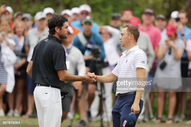 Bubba Watson of the United States shakes hands with Justin Thomas of the United States after defeating him 32 on the 16th green during the semifinal...