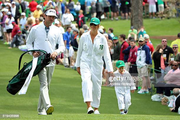 Bubba Watson of the United States walks with his wife Angie Watson and their son Caleb during the Par 3 Contest prior to the start of the of the 2016...