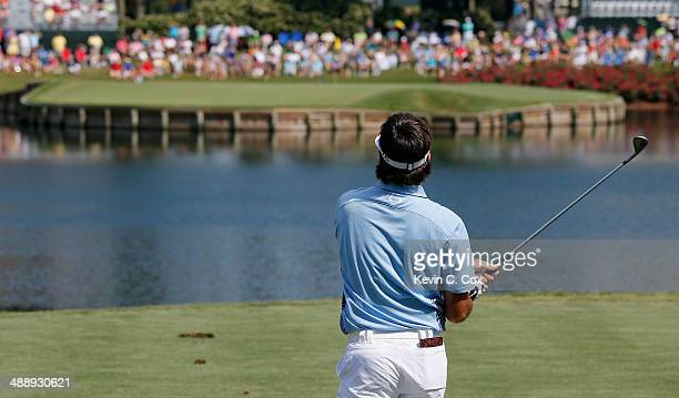 Bubba Watson of the United States watches his tee shot on the 17th hole during the second round of THE PLAYERS Championship on The Stadium Course at...