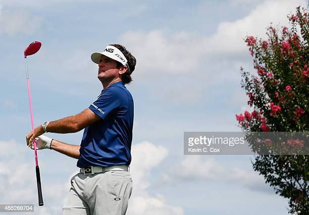 Bubba Watson of the United States watches his tee shot on the seventh hole during the first round of the TOUR Championship by Coca-Cola at the East...