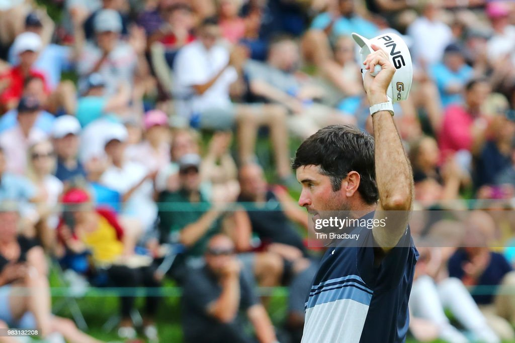 Bubba Watson of the United States waves to the gallery after making a putt for birdie on the 18th green during the final round of the Travelers Championship at TPC River Highlands on June 24, 2018 in Cromwell, Connecticut.