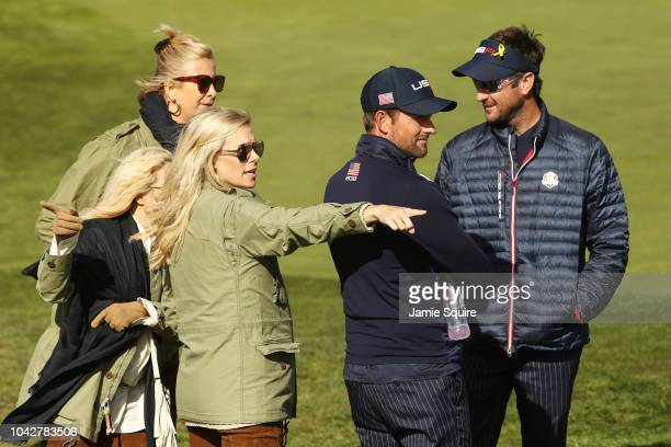 Bubba Watson of the United States wife Angie Watson chats with Webb Simpson of the United States and wife Dowd Simpson during the morning fourball...