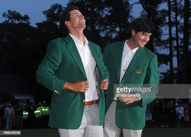 Bubba Watson of the US presents Adam Scott of Australia a Green Jacket during the Green Jacket Ceremony at 77th Masters golf tournament at Augusta...
