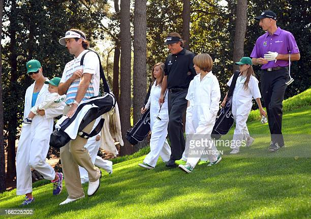 Bubba Watson of the US with his wife Angie and son Caleb Phil Mickelson of the US with his kids Evan Amanda and Sophia and Jim Furyk of the US with...