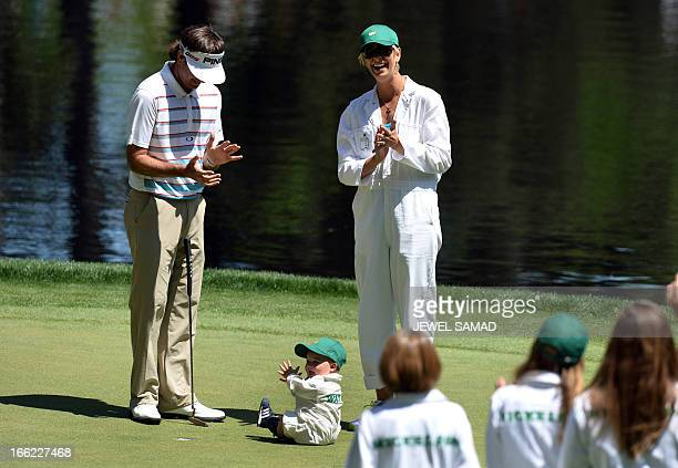 Bubba Watson of the US with his wife Angie Watson and son Caleb Watson during the Par 3 Contest held the day before the start of the 77th Masters...