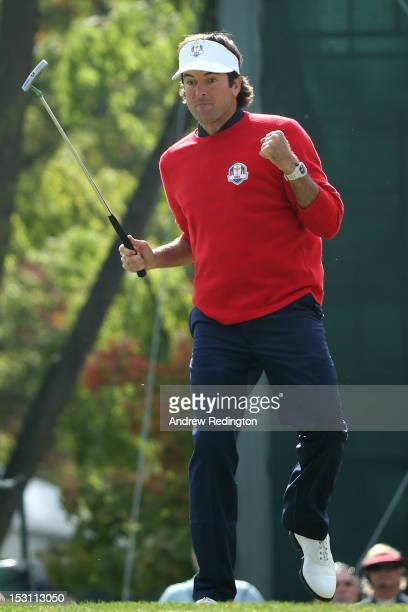 Bubba Watson of the USA celebrates a birdie putt on the first green during the Singles Matches for The 39th Ryder Cup at Medinah Country Club on...
