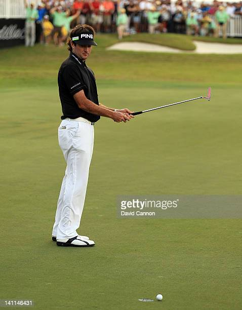 Bubba Watson of the USA just misses a short birdie putt to tie on the 18th green during the final round of the World Golf Championship Cadillac...