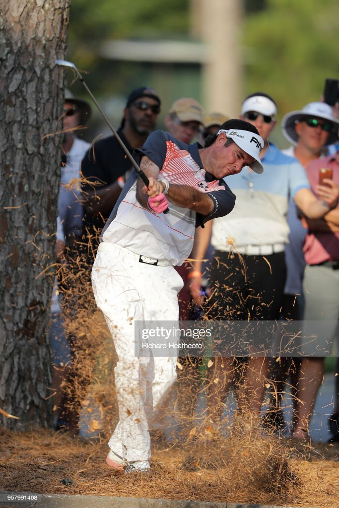 Bubba Watson of the USA plays a shot from the pine straw on the 18th hole during the second round of THE PLAYERS Championship on the Stadium Course at TPC Sawgrass on May 11, 2018 in Ponte Vedra Beach, Florida.