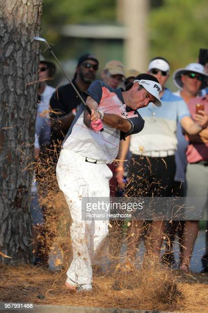 Bubba Watson of the USA plays a shot from the pine straw on the 18th hole during the second round of THE PLAYERS Championship on the Stadium Course...