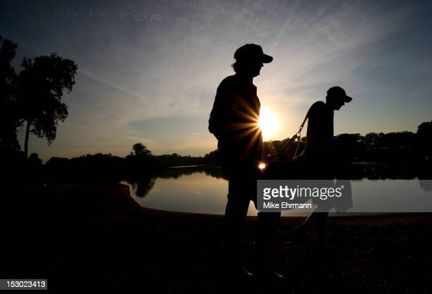 Bubba Watson of the USA walks with his caddie Ted Scott on the second hole during day two of the Morning Foursome Matches for The 39th Ryder Cup at...