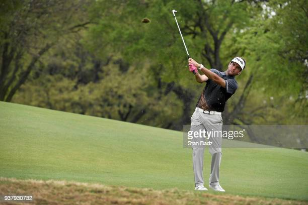 Bubba Watson plays a chip shot on the tenth hole during the championship match at the World Golf ChampionshipsDell Technologies Match Play at Austin...