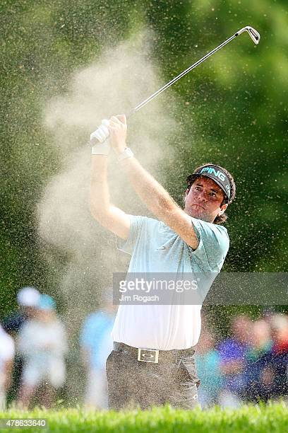 Bubba Watson plays a shot from a bunker on the 13th hole during the second round of the Travelers Championship at TPC River Highlands on June 26 2015...