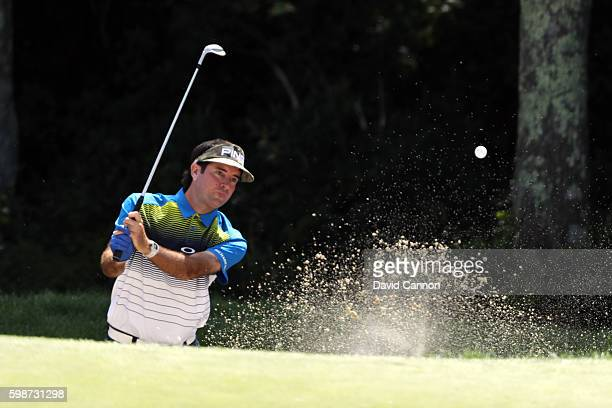 Bubba Watson plays a shot from a bunker on the 18th hole during the first round of the Deutsche Bank Championship at TPC Boston on September 2 2016...