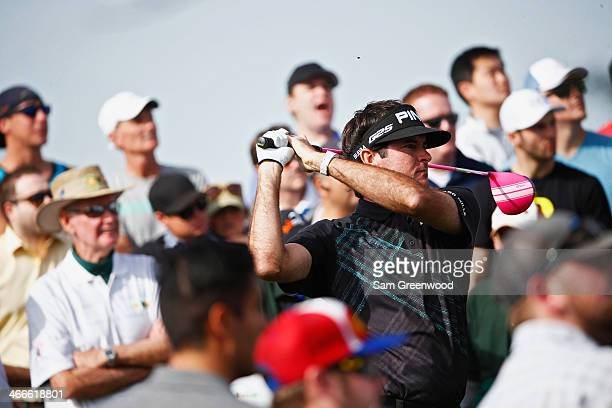 Bubba Watson plays a shot on the 15th hole during the final round of the Waste Management Phoenix Open at TPC Scottsdale on February 2 2014 in...