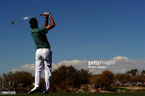 Bubba Watson plays a shot on the 17th hole during the third round of the Waste Management Phoenix Open at TPC Scottsdale on February 1, 2014 in...