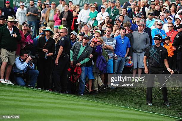 Bubba Watson plays a shot on the 18th hole during the final round of the Waste Management Phoenix Open at TPC Scottsdale on February 2 2014 in...