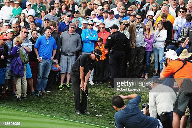 Bubba Watson plays a shot on the 18th hole in the final round of the Waste Management Phoenix Open at TPC Scottsdale on February 2 2014 in Scottsdale...