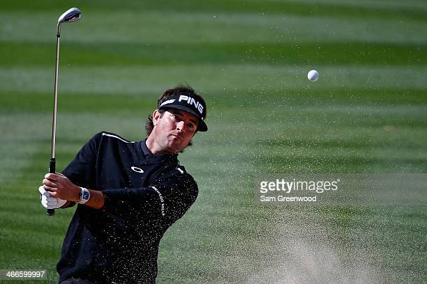 Bubba Watson plays a shot on the 9th hole during the final round of the Waste Management Phoenix Open at TPC Scottsdale on February 2 2014 in...
