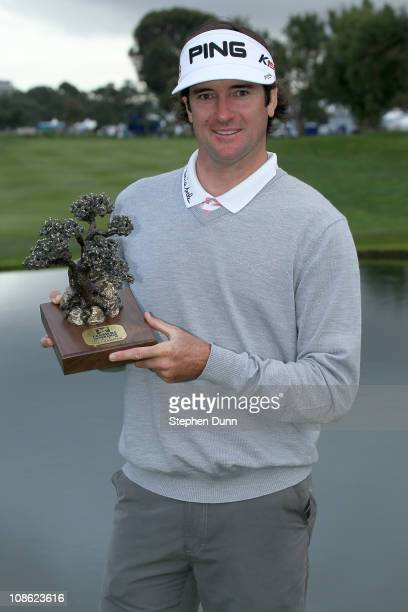 Bubba Watson poses with the trophy after his win in the final round of the Farmers Insurance Open at Torrey Pines South Course on January 30, 2011 in...
