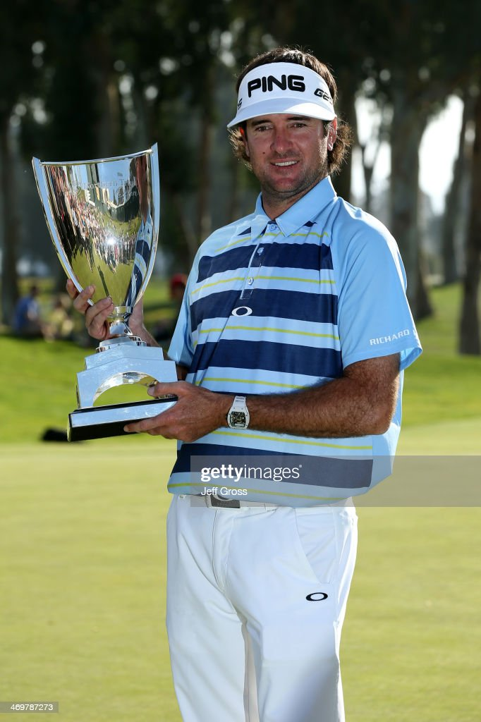 Bubba Watson poses with the trophy after winning the Northern Trust Open at the Riviera Country Club on February 16, 2014 in Pacific Palisades, California.
