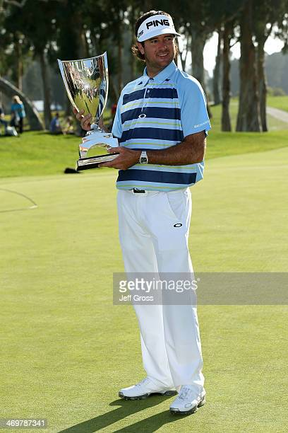 Bubba Watson poses with the trophy after winning the Northern Trust Open at the Riviera Country Club on February 16 2014 in Pacific Palisades...