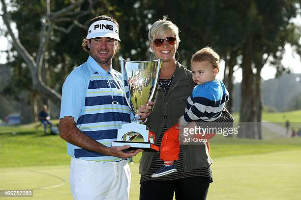Bubba Watson poses with the trophy and his wife Angie and son Caleb after winning the Northern Trust Open at the Riviera Country Club on February 16...