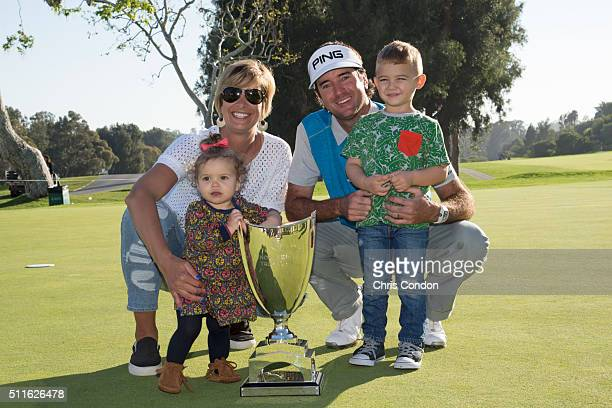 Bubba Watson poses with wife Angie and children Dakota and Caleb after winning the Northern Trust Open at Riviera Country Club on February 21 2016 in...