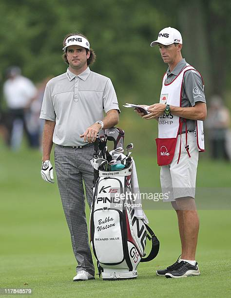 Bubba Watson prepares to make an approach shot during the second round of the Travelers Championship at TPC River Highlands on June 24 2011 in...