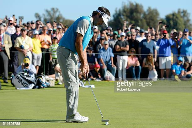 Bubba Watson putts in to win on the 18th hole during the final round of the Northern Trust Open at Riviera Country Club on February 21 2016 in...