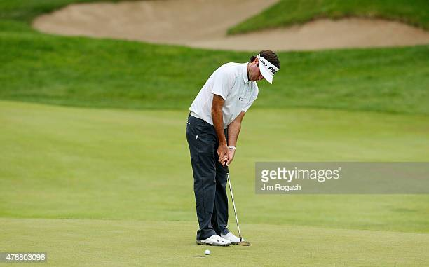 Bubba Watson putts on the 15th green during the third round of the Travelers Championship at TPC River Highlands on June 27 2015 in Cromwell...