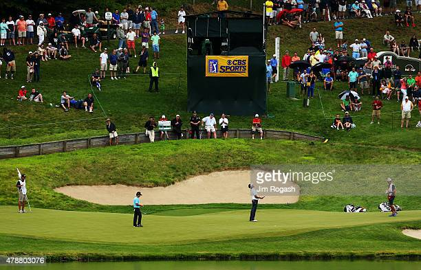 Bubba Watson putts on the 16th green during the third round of the Travelers Championship at TPC River Highlands on June 27 2015 in Cromwell...