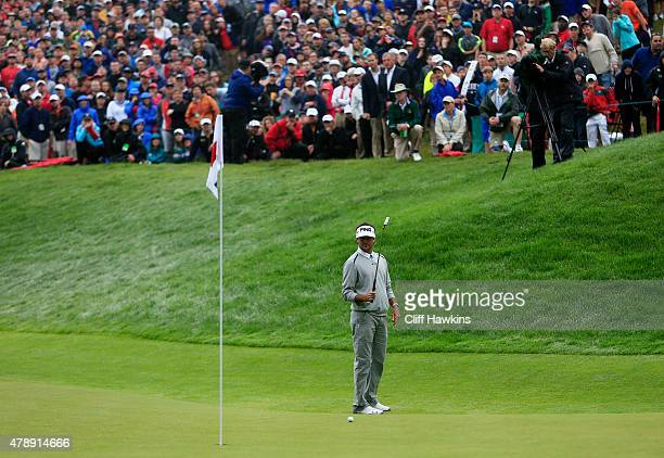 Bubba Watson putts on the 18th green during the final round of the Travelers Championship at TPC River Highlands on June 28 2015 in Cromwell...