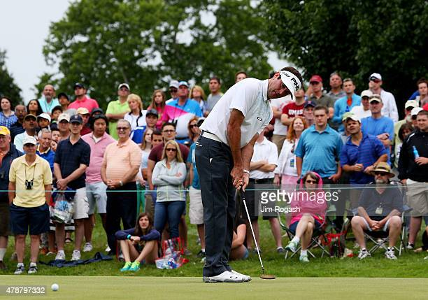 Bubba Watson putts on the fourth green during the third round of the Travelers Championship at TPC River Highlands on June 27 2015 in Cromwell...